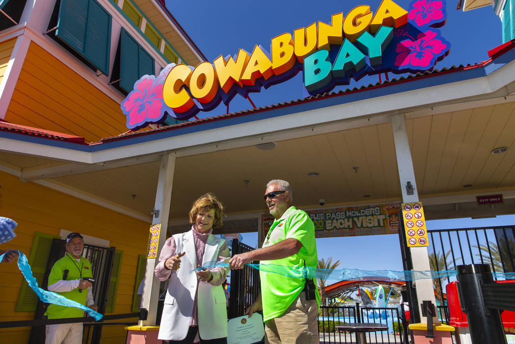 Rep. Susie Lee and General Manager Marc Glissman cut a ribbon to celebrate opening day for the ...