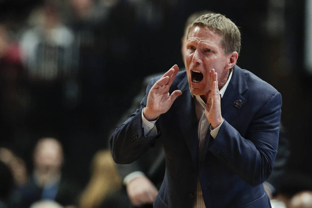 Gonzaga coach Mark Few shouts during the second half of the team's West Regional final against ...