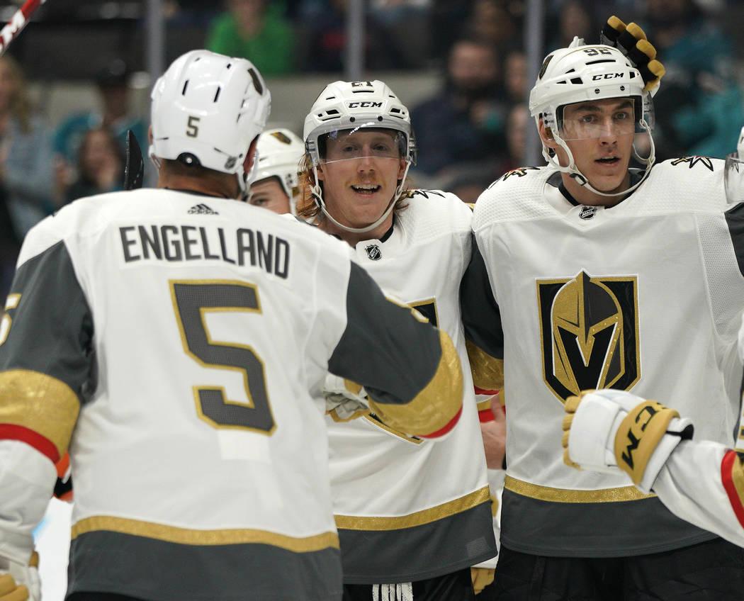 Vegas Golden Knights center Cody Eakin, center, celebrates his goal against the San Jose Sharks ...