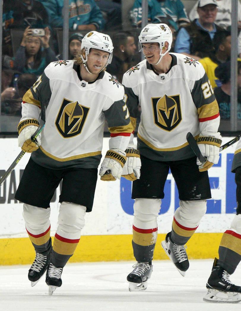 Vegas Golden Knights center William Karlsson (71) is congratulated by teammate Nick Holden (22) ...