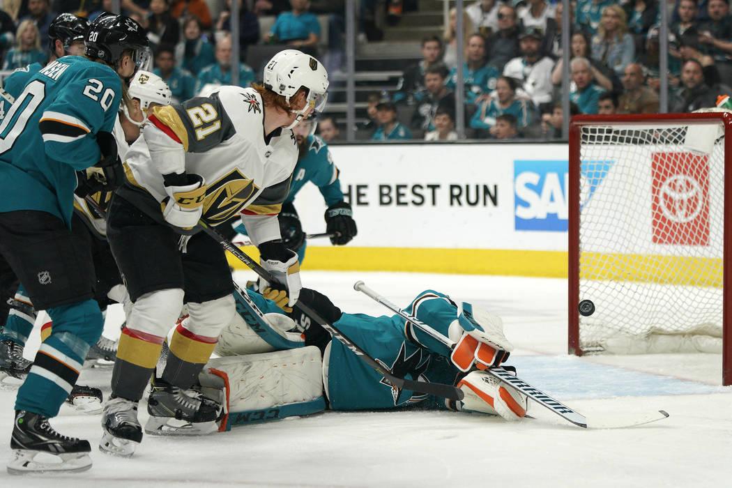Vegas Golden Knights center Cody Eakin (21) scores a goal over San Jose Sharks goaltender Marti ...