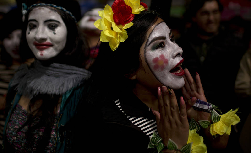 Mimes take part in a candlelight vigil marking Earth Hour in La Paz, Bolivia, Saturday, March 3 ...