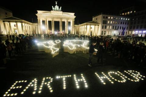 Activists of the World Wide Fund For Nature (WWF) set up led-lights in front of the illuminated ...