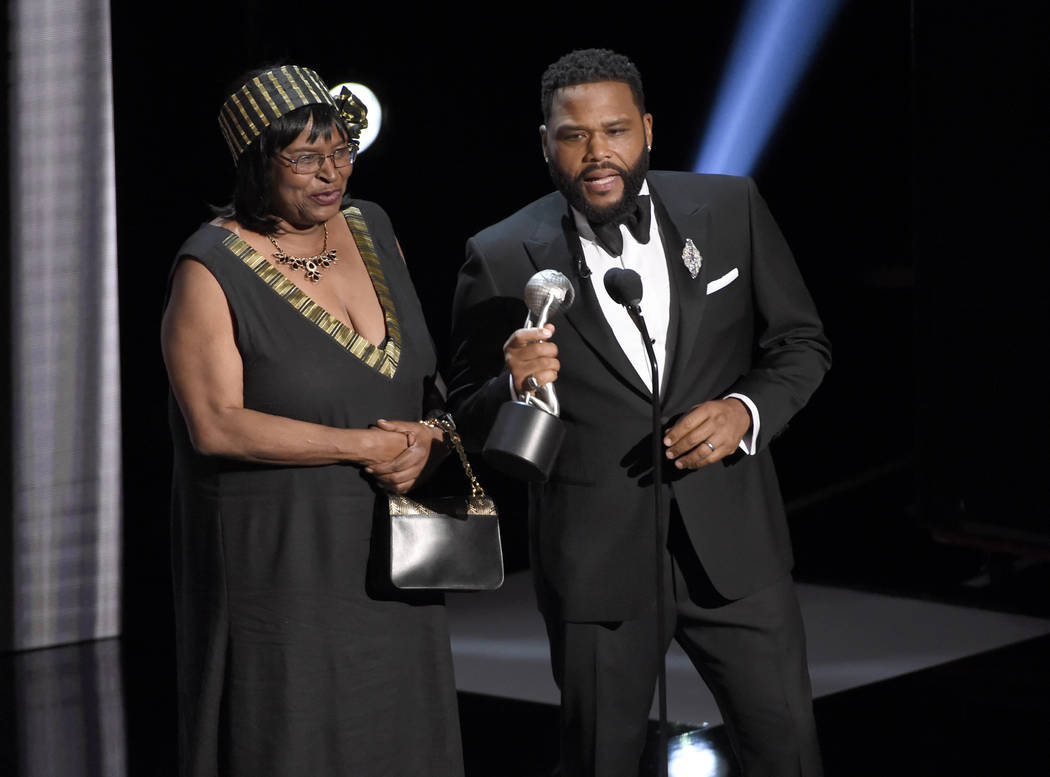 """Anthony Anderson, right, accepts the award for outstanding actor in a comedy series for """"b ..."""