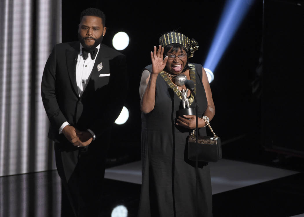 """Anthony Anderson, left, accepts the award for outstanding actor in a comedy series for """"bl ..."""