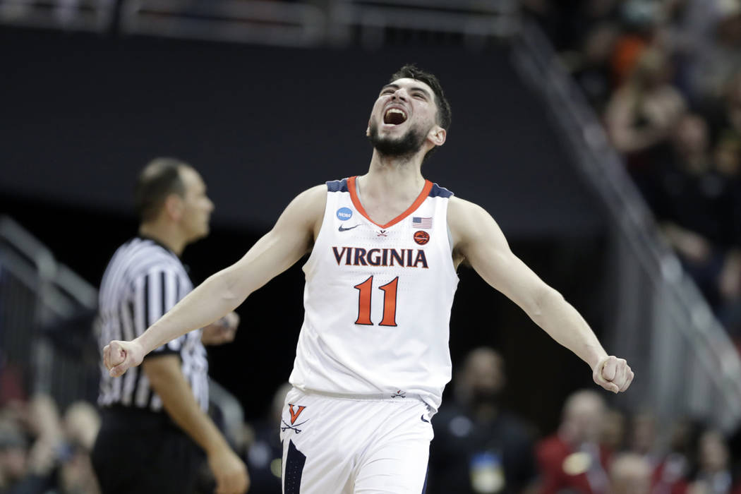 Virginia's Ty Jerome celebrates during overtime of the men's NCAA Tournament college basketball ...