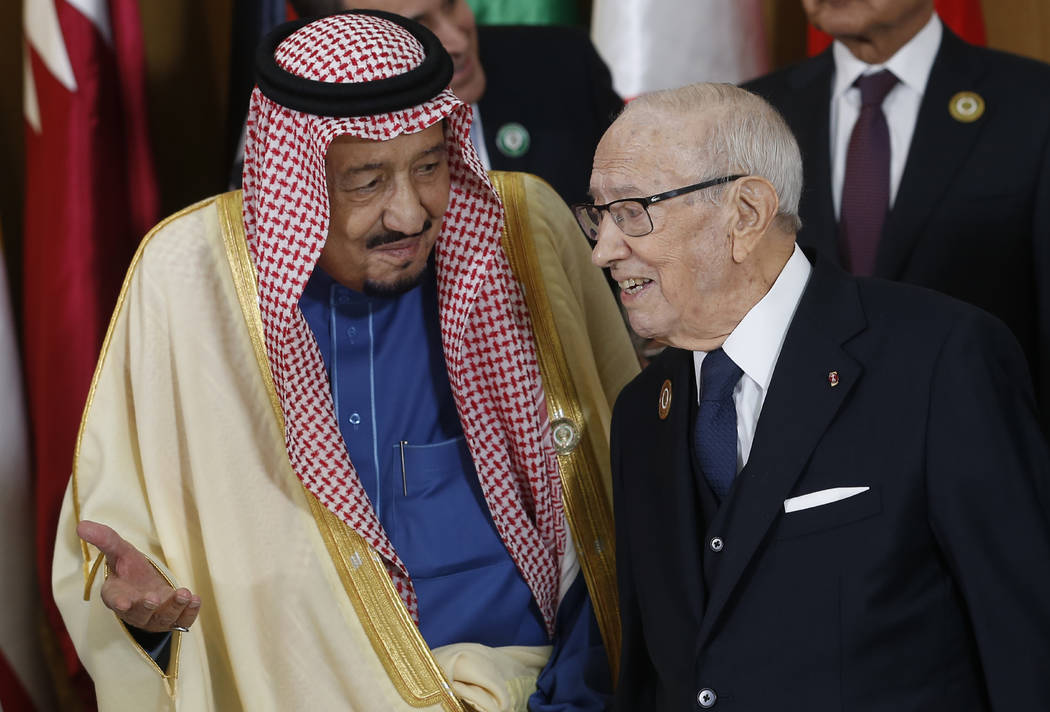 Saudi Arabia's King Salman bin Abdulaziz, left, speaks with Tunisian President Beji Caid Essebs ...