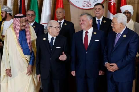 Tunisian President Beji Caid Essebsi, center left, stands with Saudi Arabia's King Salman bin A ...