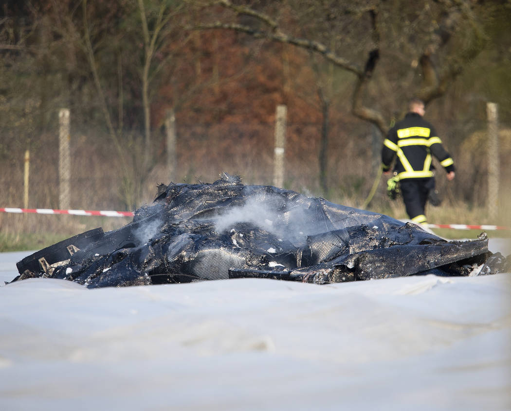 The burnt out debris of a small aircraft lies on a field near the small airport of Egelsbach ne ...