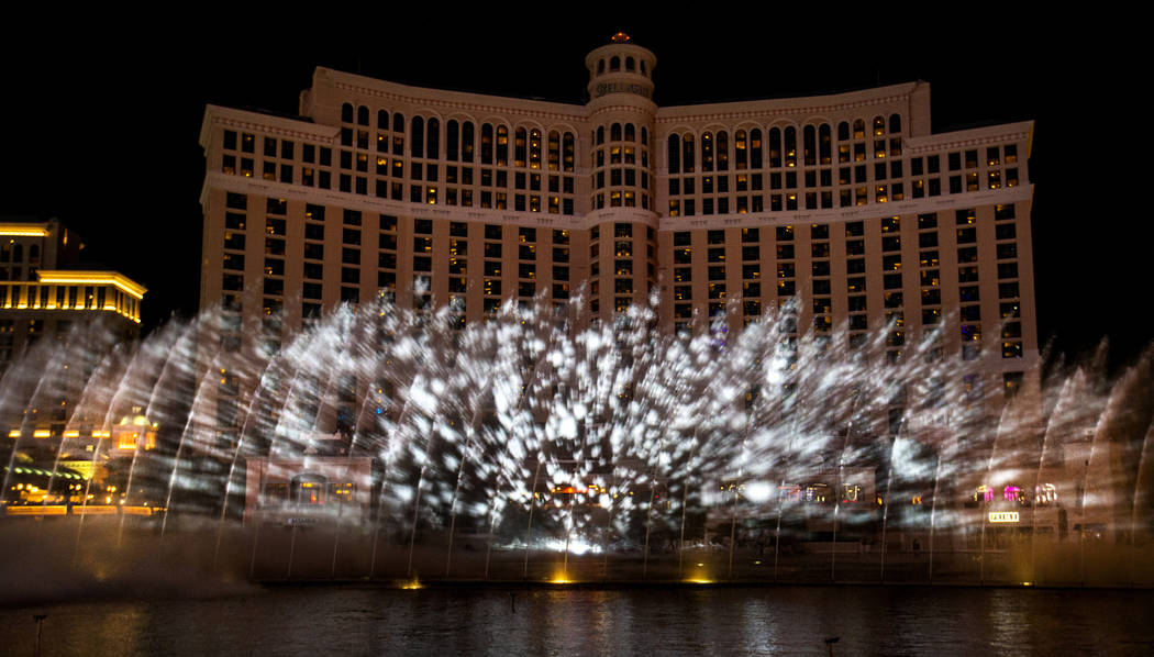 Snow falls during the debut of the new water show based on ÒGame of ThronesÓ at the B ...