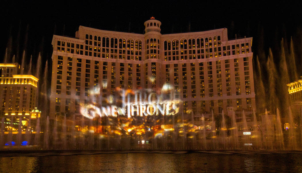 The logo is projected during the debut of the new water show based on ÒGame of Thrones&#xd ...