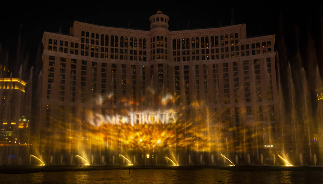 """The logo is projected during the debut of the new water show based on """"Game of Thrones&quo ..."""