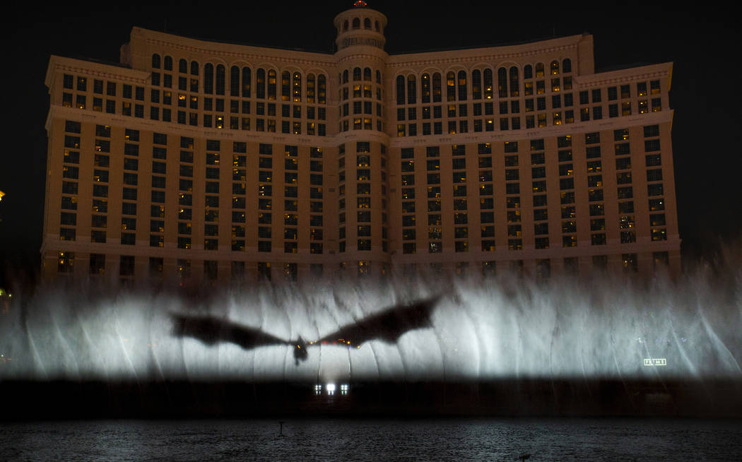 """A dragon arrives during the debut of the new water show based on """"Game of Thrones"""" at ..."""