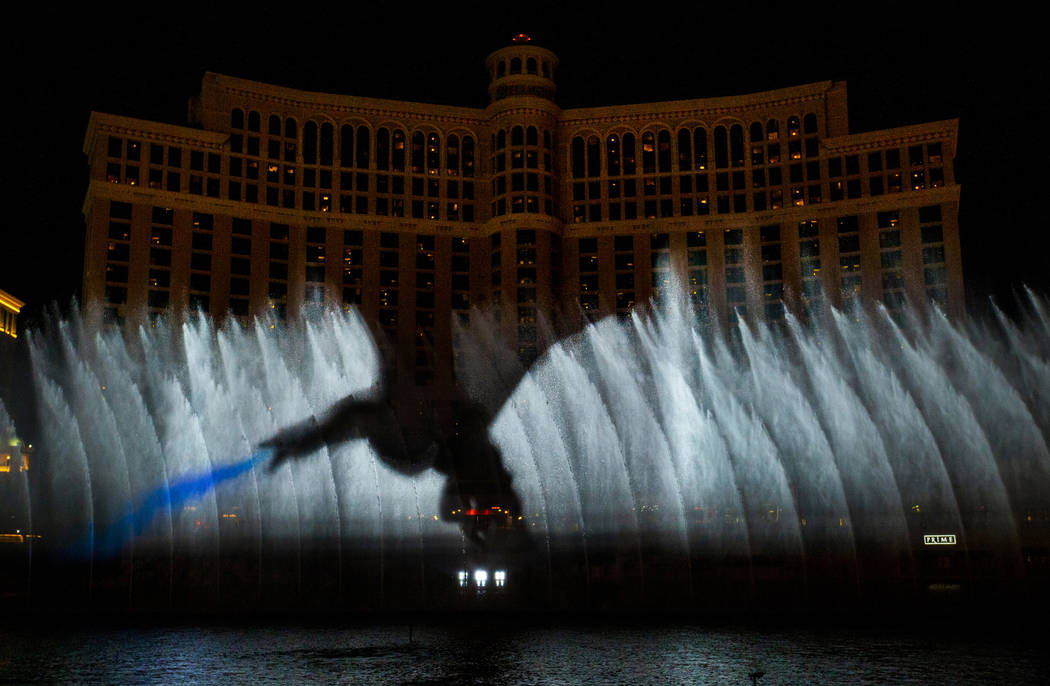 A dragon breathes fire during the debut of the new water show based on ÒGame of Thrones&#x ...