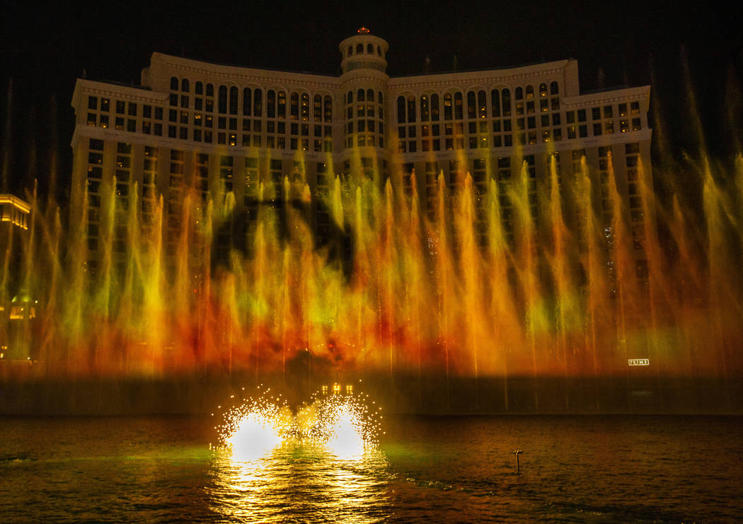 A dragon flies into the flames during the debut of the new water show based on ÒGame of Th ...