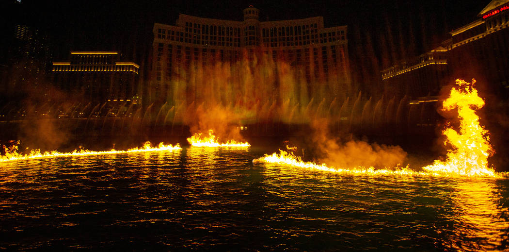 Flames burn on the water during the debut of the new water show based on ÒGame of Thrones& ...