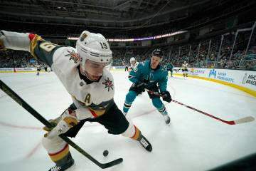Vegas Golden Knights right wing Reilly Smith (19) battles for the puck against San Jose Sharks ...