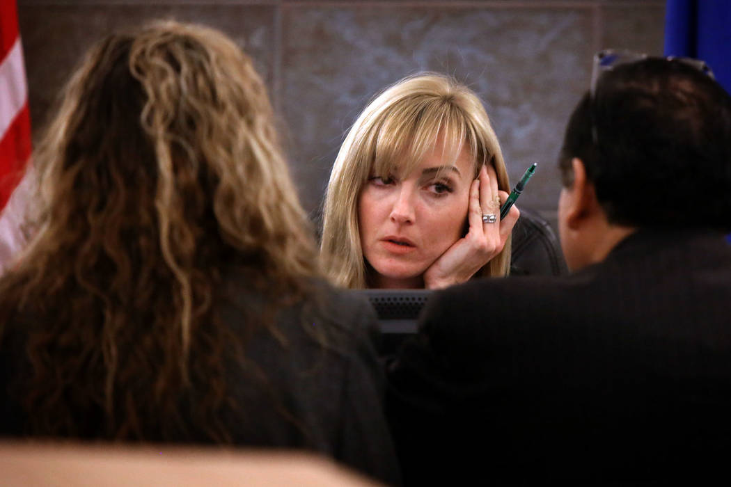 In this Feb.,13, 2013, photo, district court judge Stefany Miley listens to defense attorney Do ...