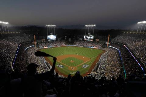 FILE - In this Oct. 27, 2018, file photo, fans cheer from the top of Dodger Stadium during Game ...