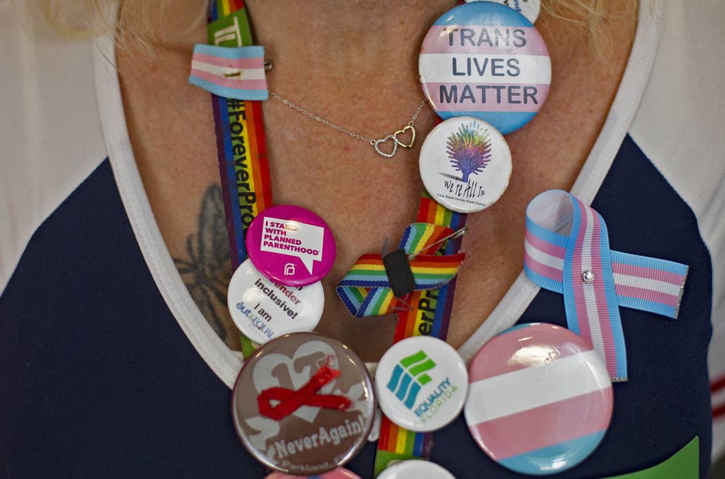 Samantha Palaggi shows off buttons collected from across the United States at the Trans Day of ...