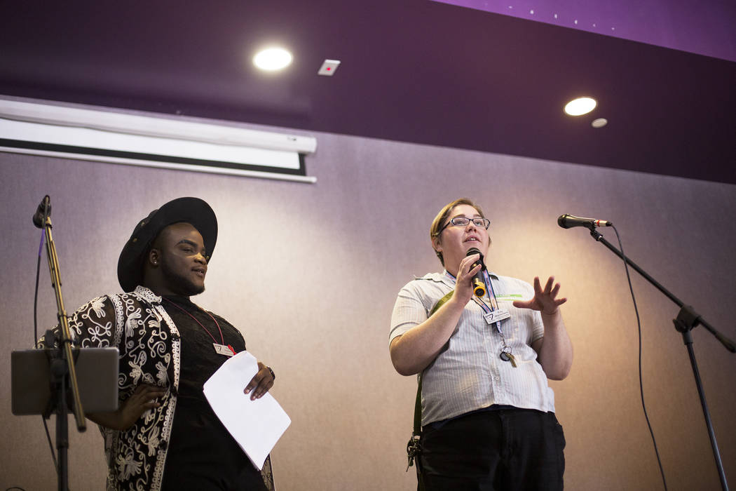 Ray Macfarlane, the trans & gender diversity program manager, speaks to the crowd next to h ...