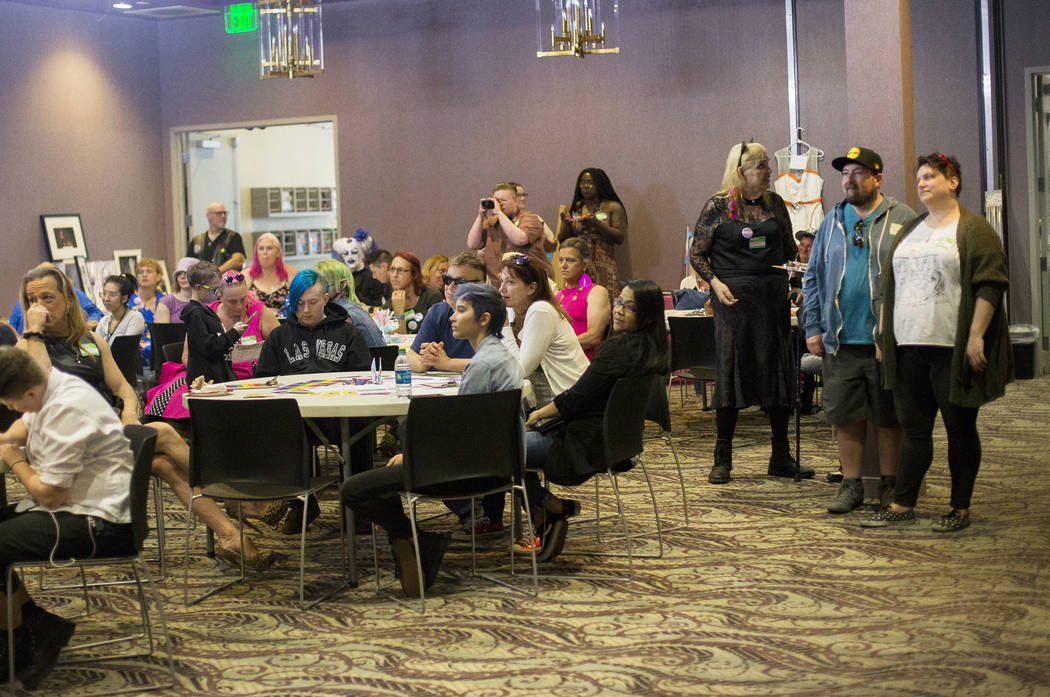 The crowd listens to transgender people as they share their stories at the Trans Day of Visibil ...