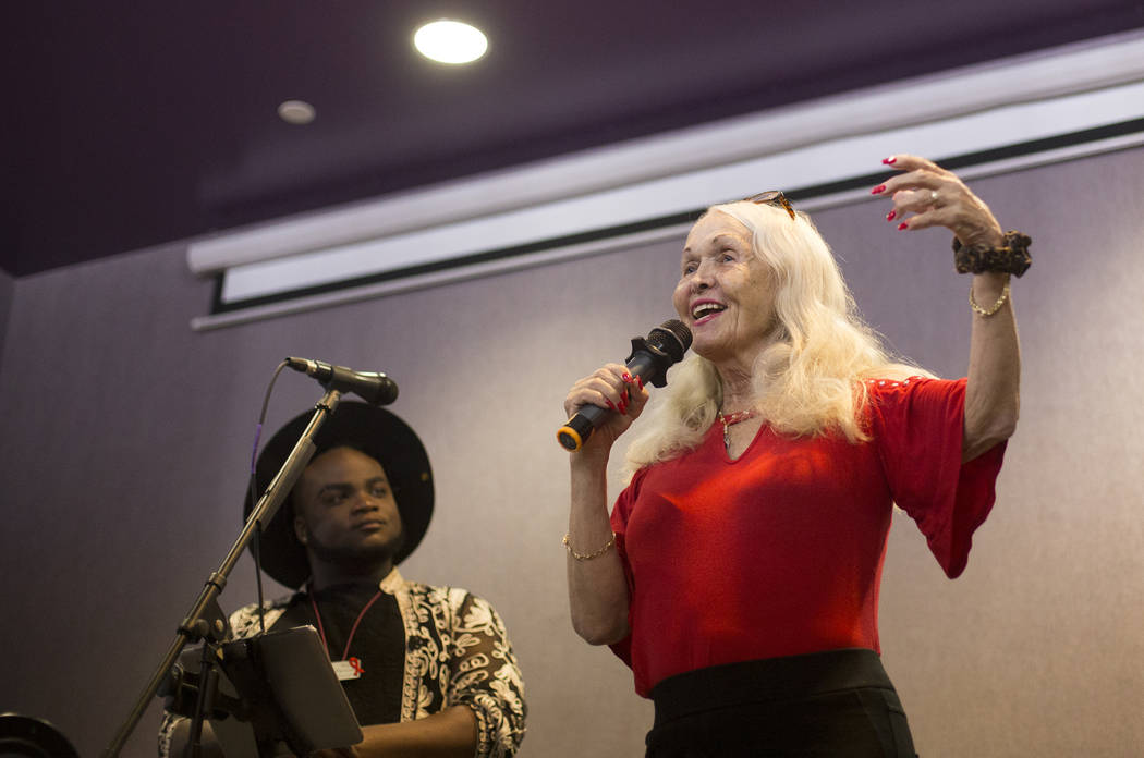 Judy Bowen speaks to the crowd next to host Rio Perkins at the Trans Day of Visibility event at ...
