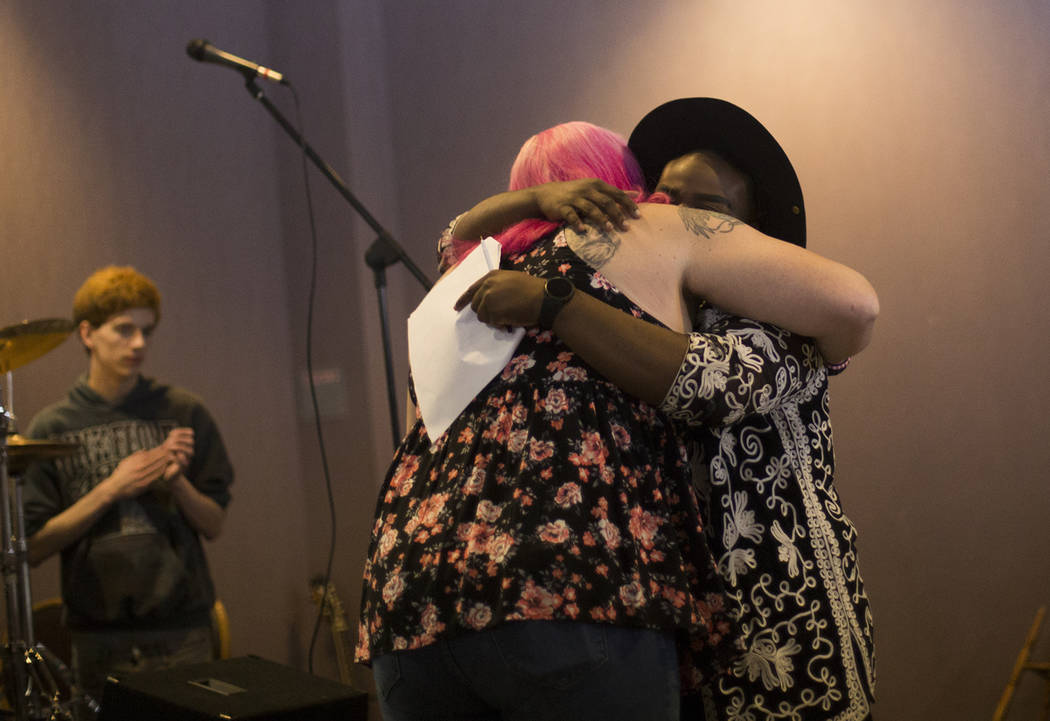 Rachel Rogers hugs host Rio Perkins after sharing her story at the Trans Day of Visibility even ...