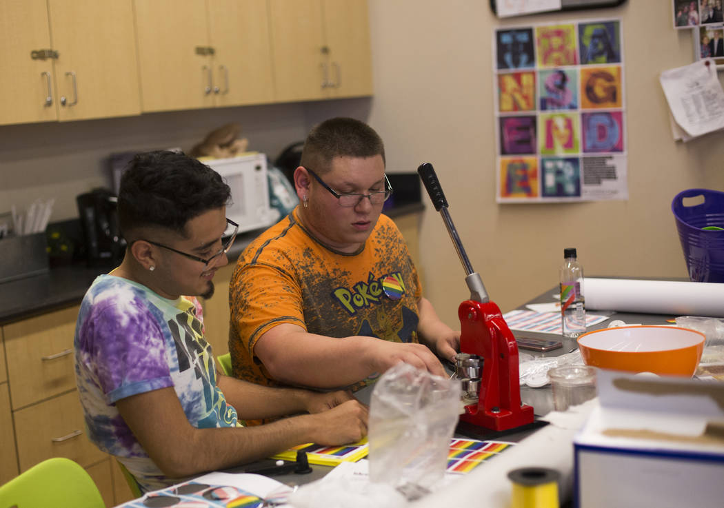 Jose Martinez, left, works with Michael Limon to make buttons at the Trans Day of Visibility ev ...