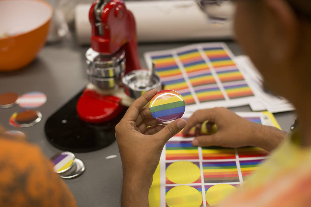 Michael Limon, left, works with Jose Martinez to make buttons at the Trans Day of Visibility ev ...