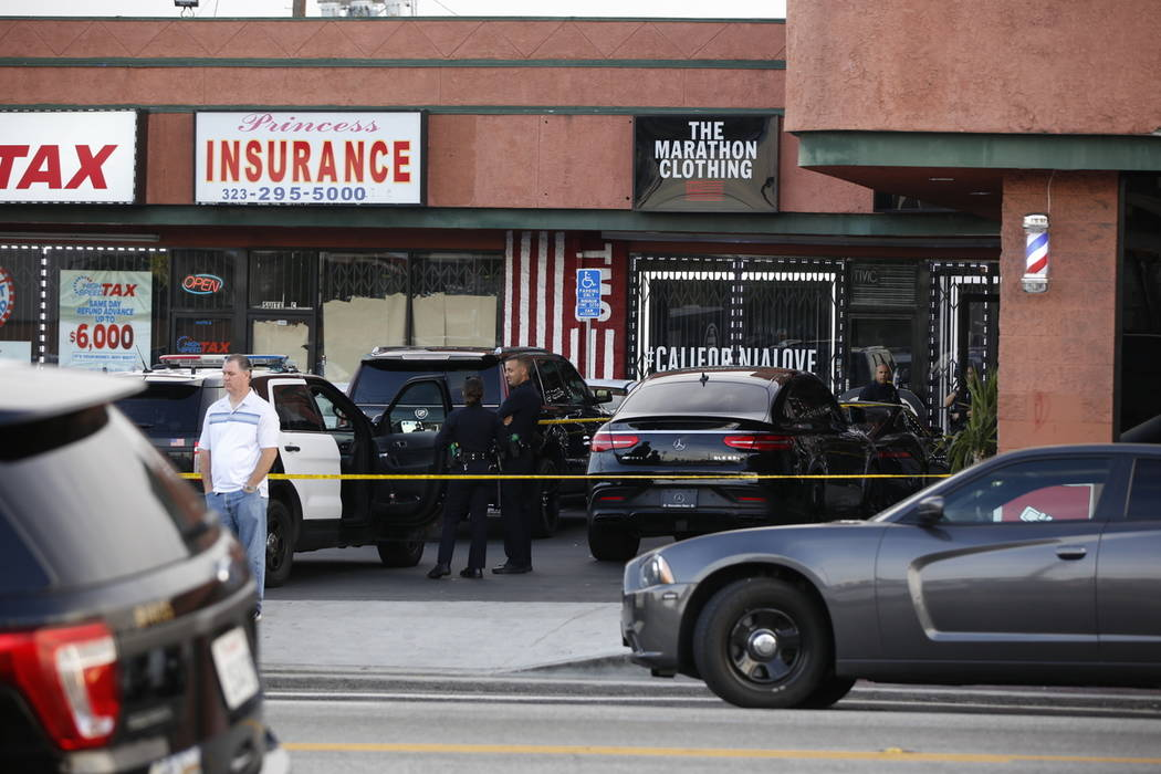 Los Angeles Police officers guard the Marathon Clothing store of rapper Nipsey Hussle after a s ...