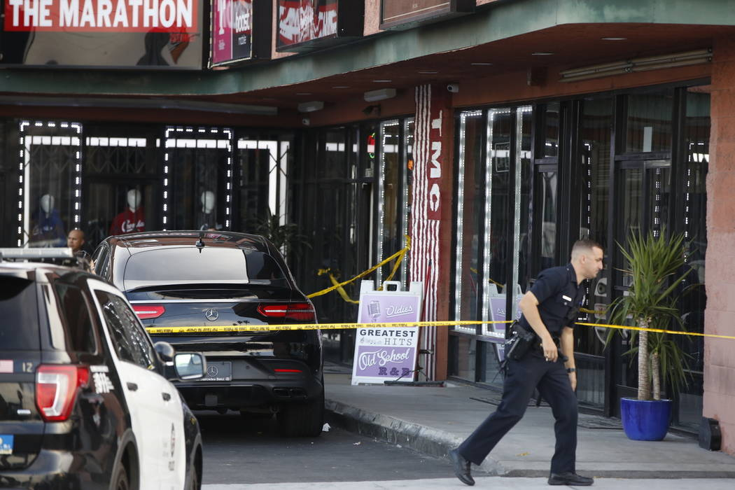 A Los Angeles Police officer walks past the taped Marathon Clothing store of Rapper Nipsey Huss ...