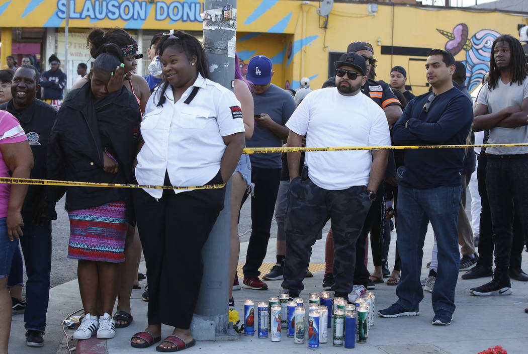 People gather around the Marathon Clothing Co. store of rapper Nipsey Hussle after a shooting i ...