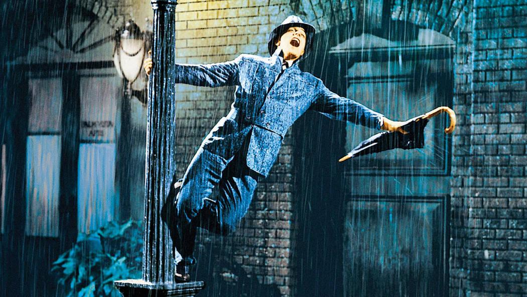 """Gene Kelly sings the title tune in """"Singin' in the Rain"""" (Warner Bros.)"""