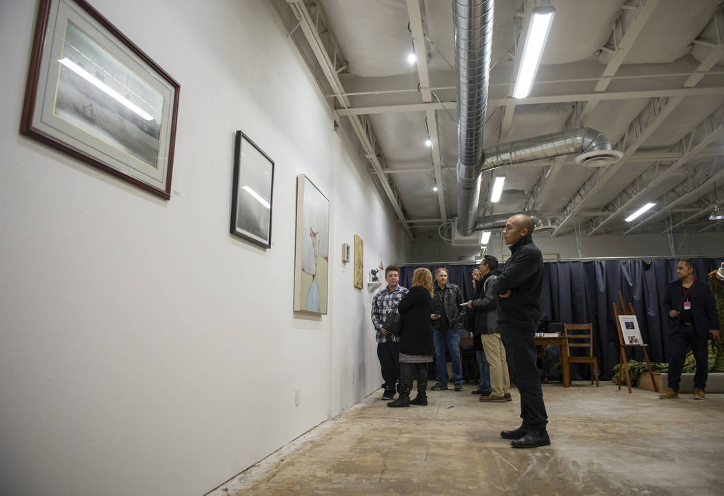 Paul Gonzales looks at the artworks on display at an exhibit at Core Contemporary Gallery in La ...
