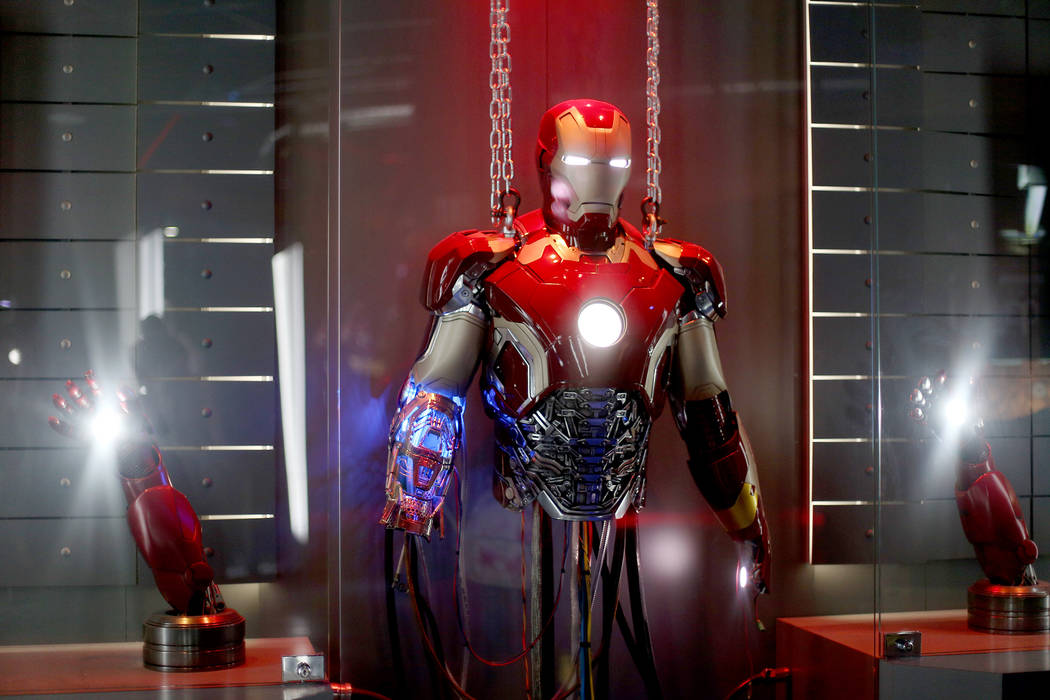 An recreated prop of an Iron Man suit at the Avengers S.T.A.T.I.O.N interactive exhibit at Trea ...