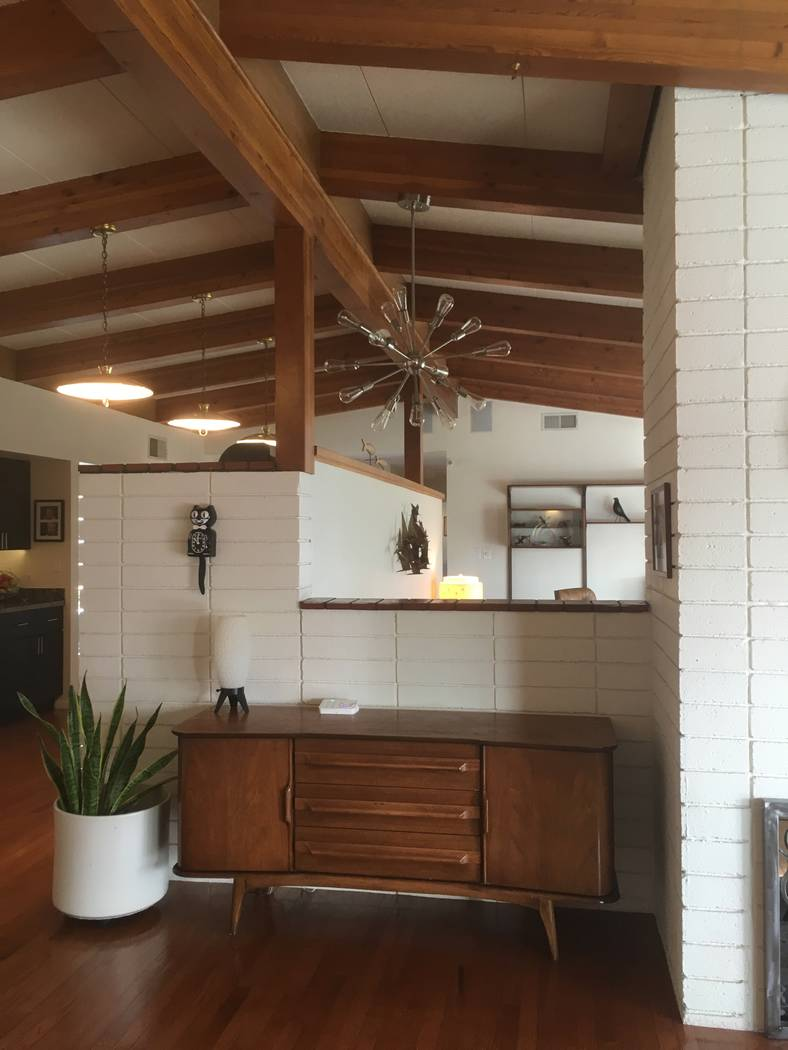 Wood details are a unifying element throughout midcentury modern design. Wood is used for decor ...