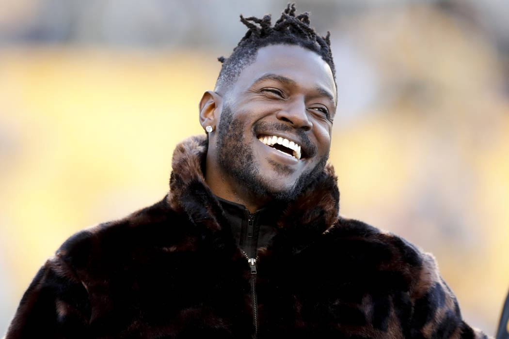 Pittsburgh Steelers wide receiver Antonio Brown stands along the sideline in street clothes bef ...