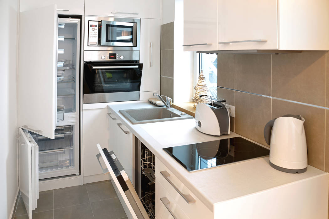 This small kitchen has everything you need: oven, microwave, two-burner cooktop, dishwasher and ...