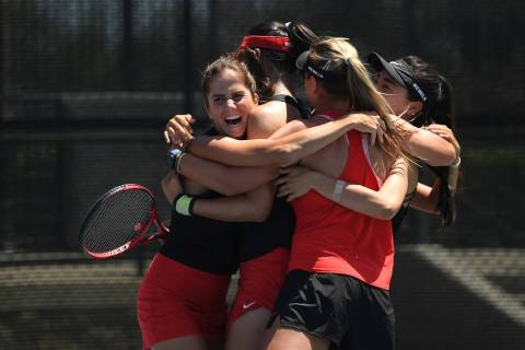 The UNLV women's tennis team celebrates after shutting out host San Diego State in the Mountain ...