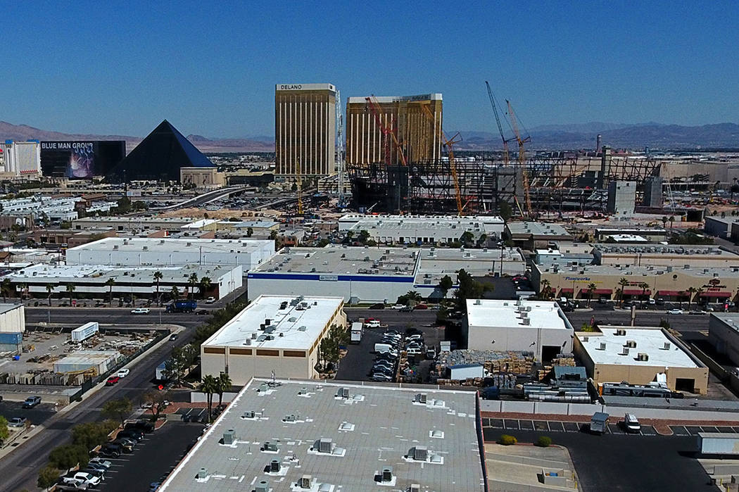 Aerial view of Raiders stadium, right center, in Las Vegas as it continues to take shape betwee ...