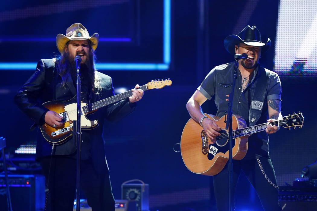 Chris Stapleton, left, and Jason Aldean perform at 2017 CMT Artist of the Year Awards at Nashvi ...