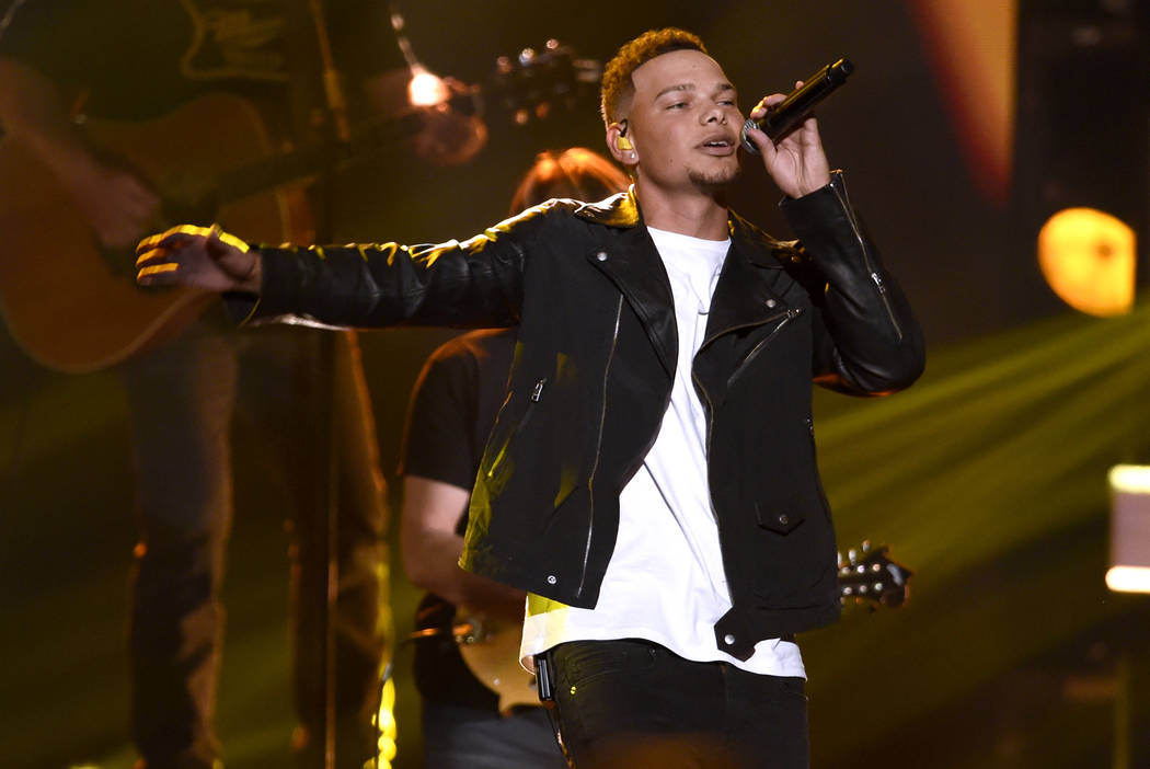 """FILE - In this Nov. 8, 2017 file photo, Kane Brown performs """"Heaven South"""" at the 51s ..."""