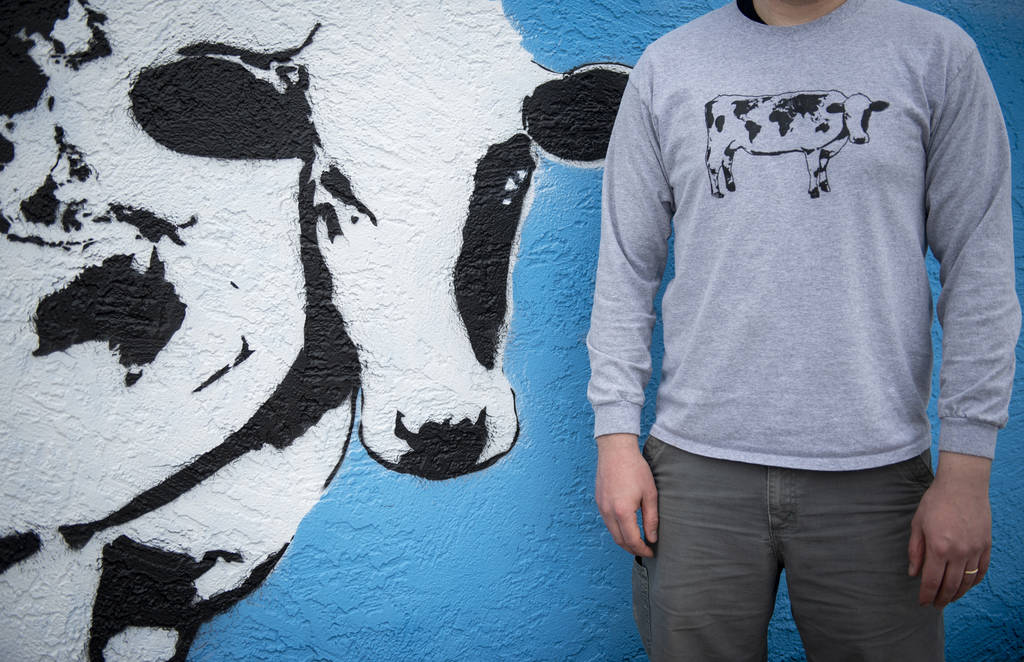 DJ Barry stands beside his mural located on the wall of Main Street Peddlers Antique Mall in do ...