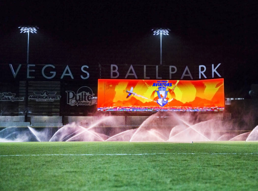 The sprinkler system waters the outfield at Las Vegas Ballpark on Tuesday, April 2, 2019, in La ...