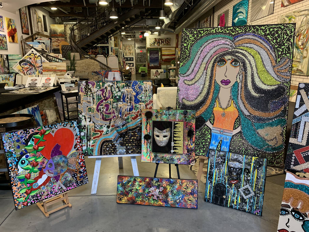 Artists Silvia Reyes uses mixed mediums for her colorful pieces that are on display at ART 2 ar ...