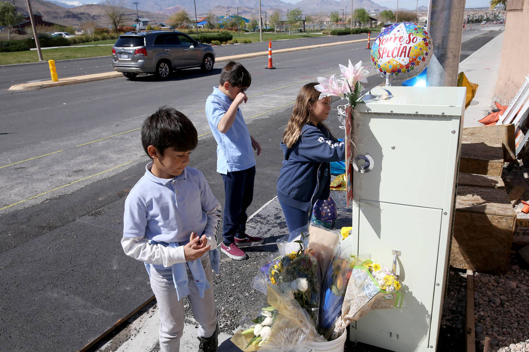 Leo Yoshimori, 9, from left, and his siblings, Talan, 11, and Evelyn, 7, visit a memorial on So ...