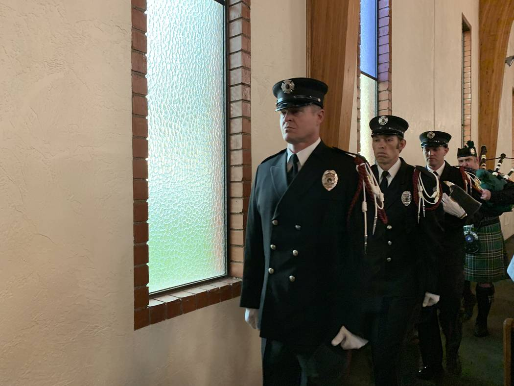 North Las Vegas Fire Department Honor Guard members Ryan Thatcher, front, Cameron Huges and Jor ...