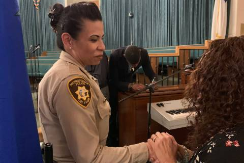 Metro police Capt. Yasenia Yatomi greets a resident at Blessing of the Badge, an event honoring ...
