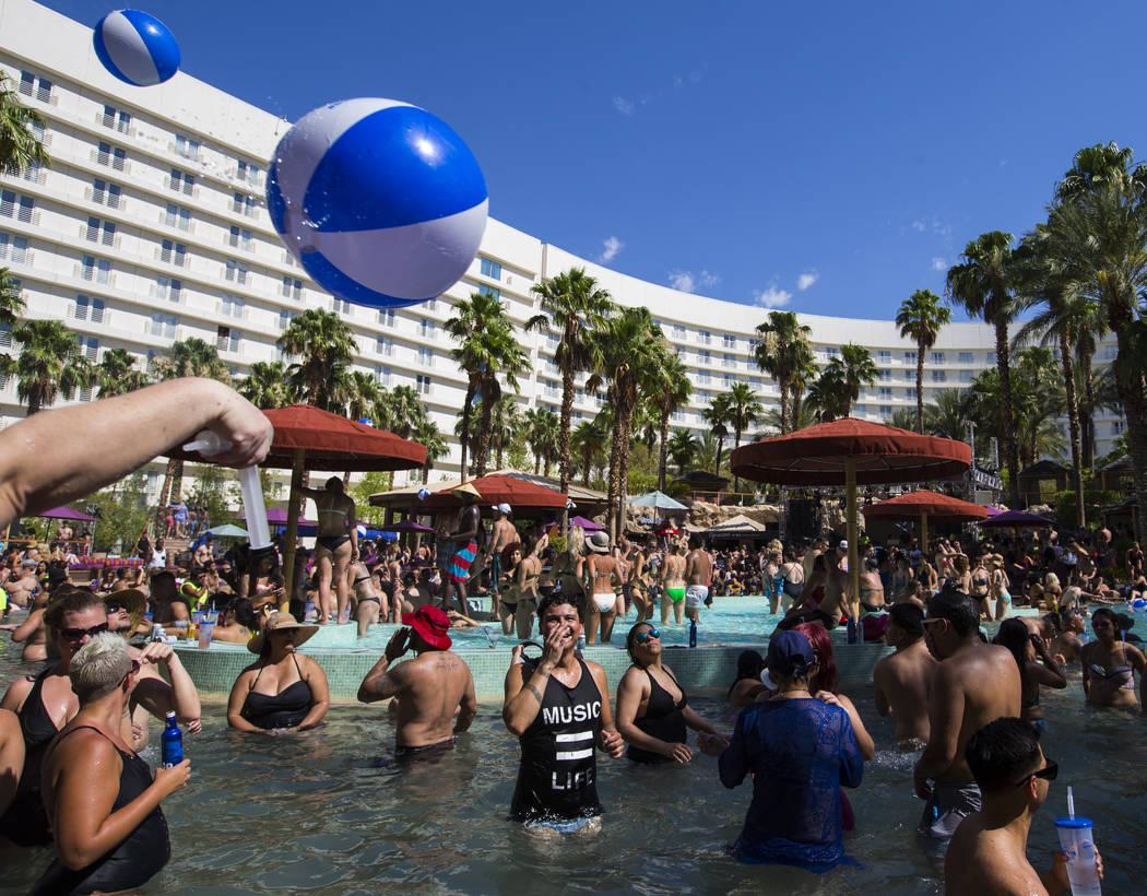People enjoy the pool at the Rehab dayclub at Hard Rock Hotel in Las Vegas on Saturday, June 24 ...